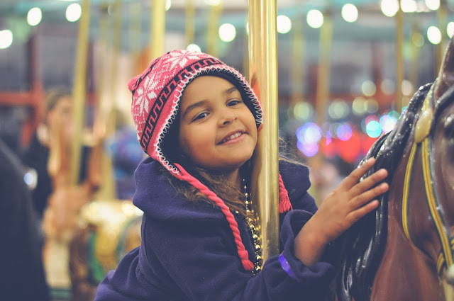 Little Girl on a carousel