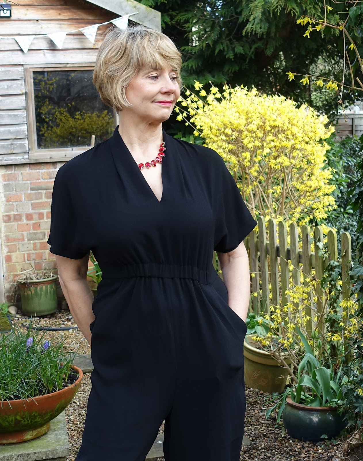 Over 40s blogger Is This Mutton? in black v-neck crepe jumpsuit from Whistles, SS18