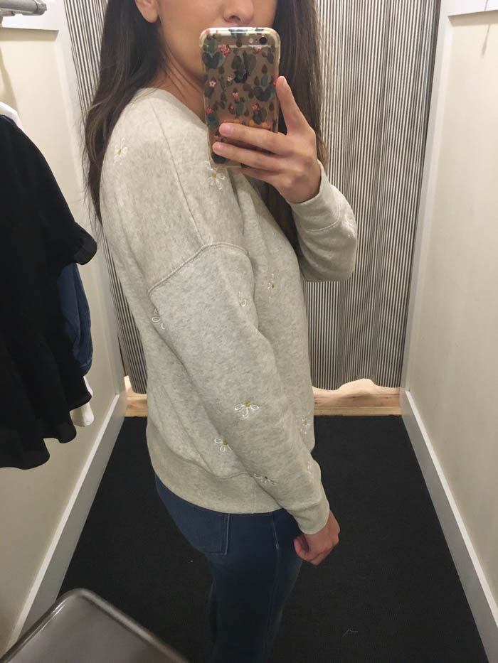 grey sweater with flowers