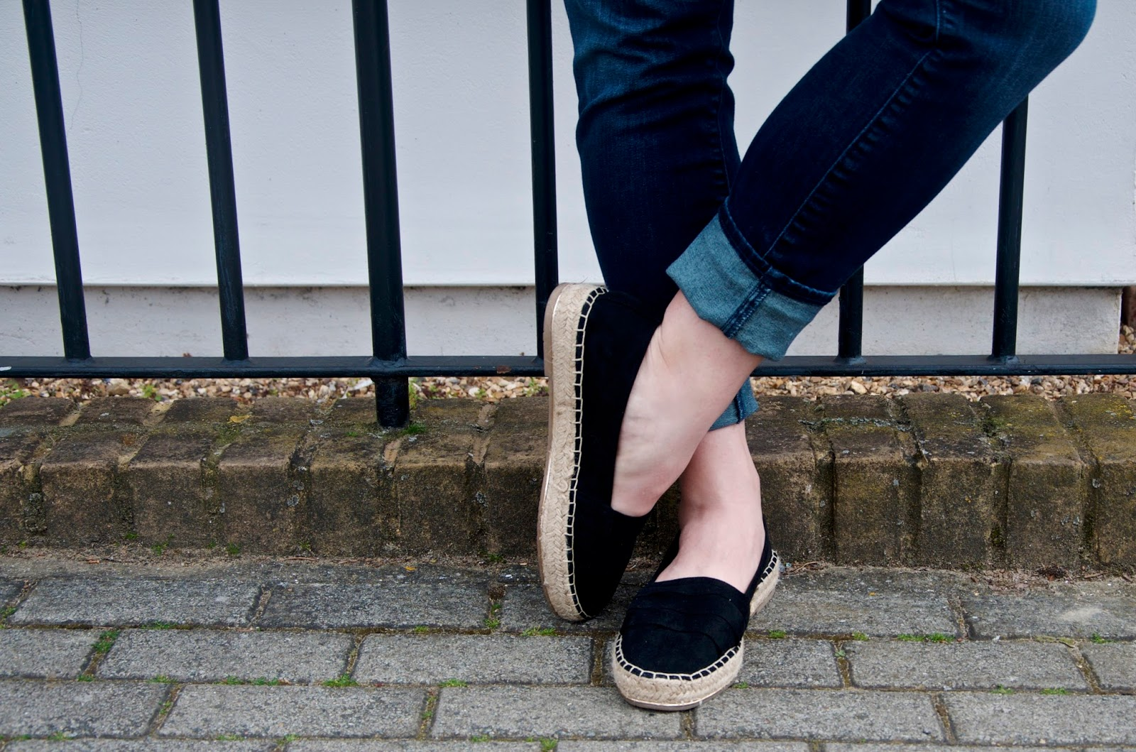 black chunky espadrilles and cuffed skinny jeans