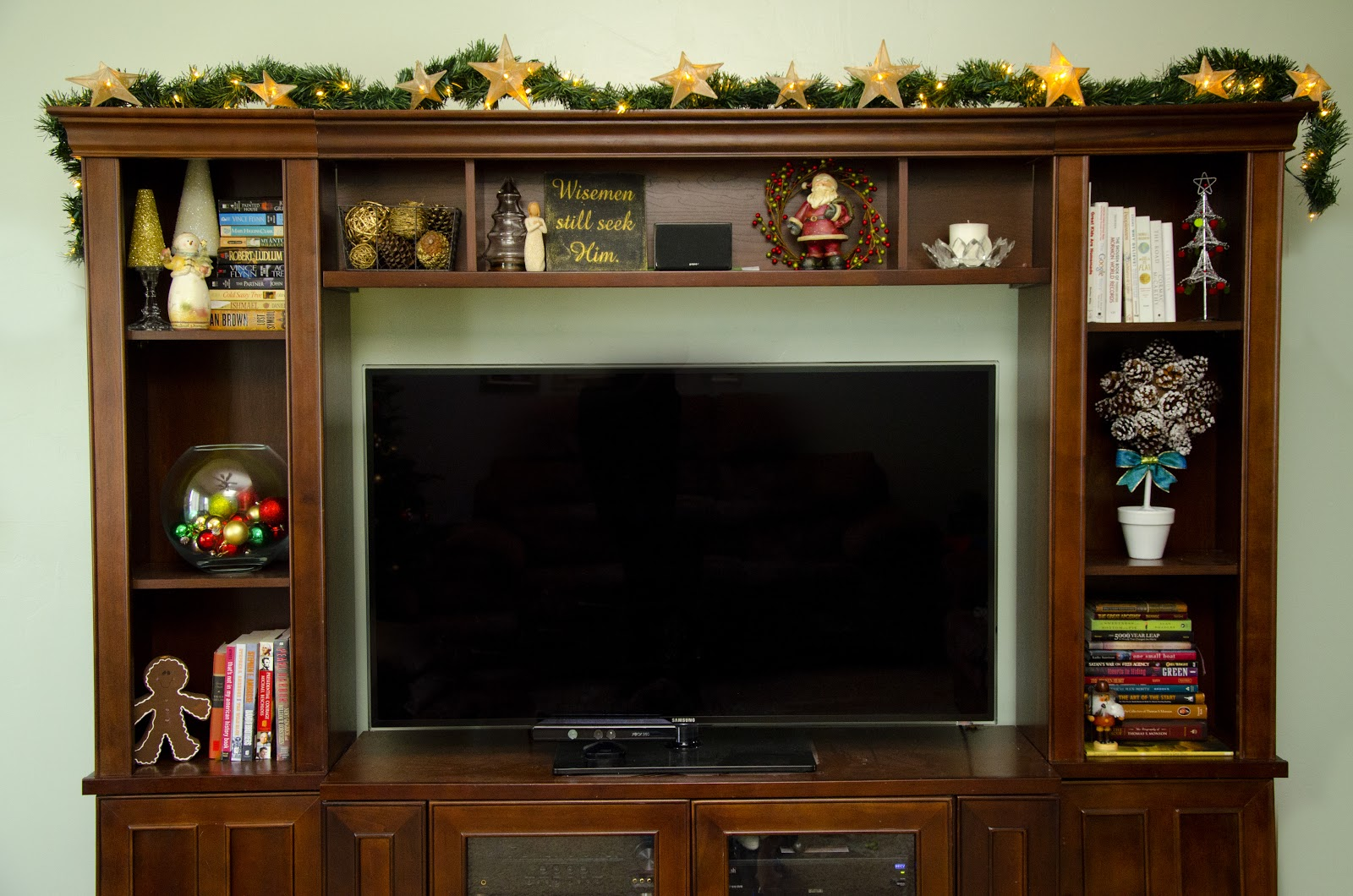 Decorating For Christmas The Entertainment Center And A Pine Cone Topiary