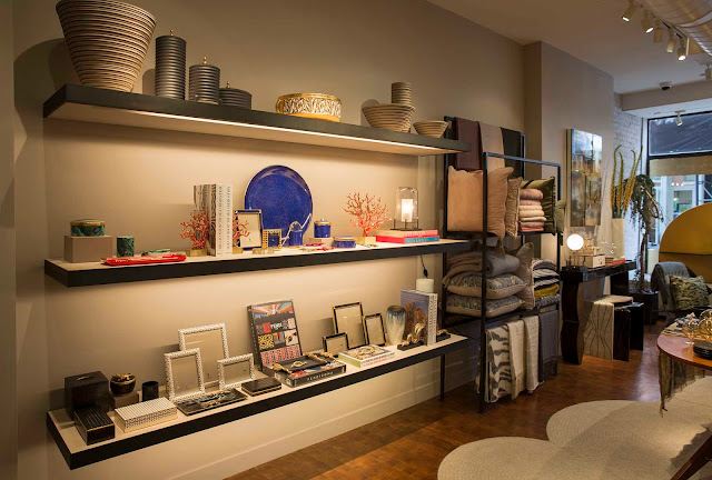 Highlights of elads lobjet collections are displayed on shelves and vintage tables of the store along with new and rare classic books vintage lighting
