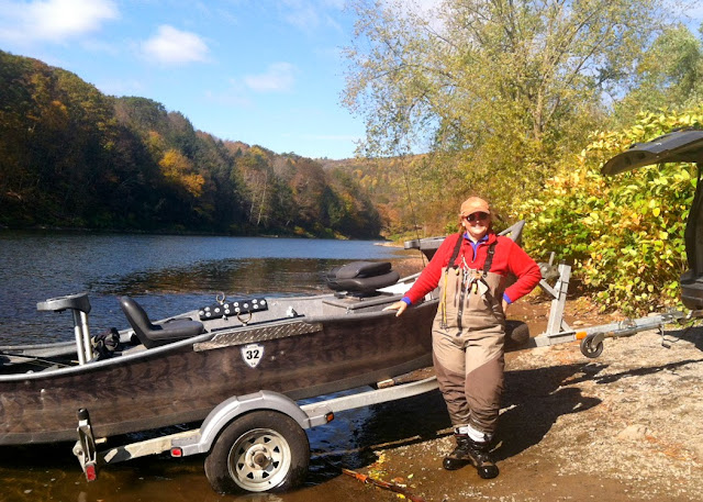 Fly fishing guide Sam Decker by her boat at Long Eddy put in on the Delaware River