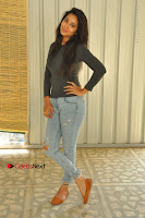 Actress Bhanu Tripathri Pos in Ripped Jeans at Iddari Madhya 18 Movie Pressmeet  0015.JPG