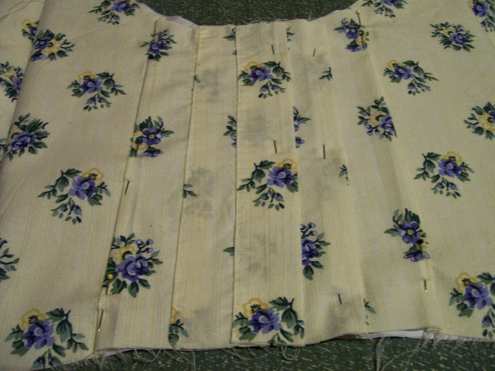 Decorative tucks on front of Regency dress bodice.