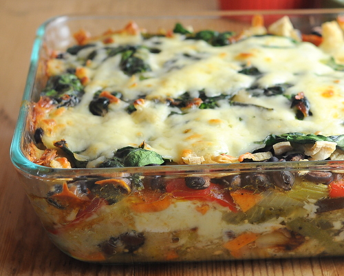 Roasted Veggie Enchilada Casserole ♥ KitchenParade.com, a Master Recipe, layers of roasted vegetables, salsa verde, corn tortillas and fresh spinach with a little cheese. One for dinner, one for the freezer.