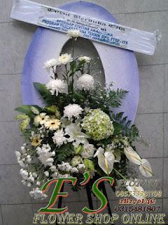 standing flower turut berduka cita