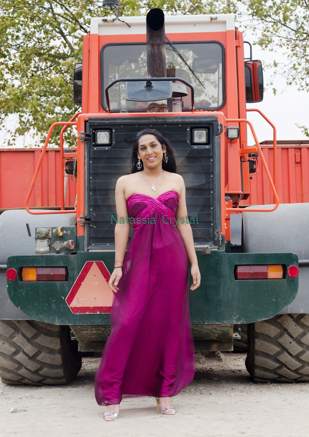 Natassia Crystal natcrys, long purple dress, in front of truck