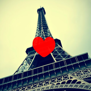 Eiffel Tower, shot from the bottom, with a heart in front of it - Bataclan Concert Hall