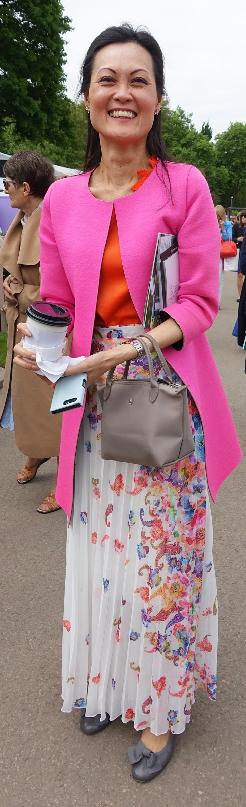 Fantastic styling of a long skirt, orange top and pink jacket by a visitor to the Chelsea Flower Show 2017