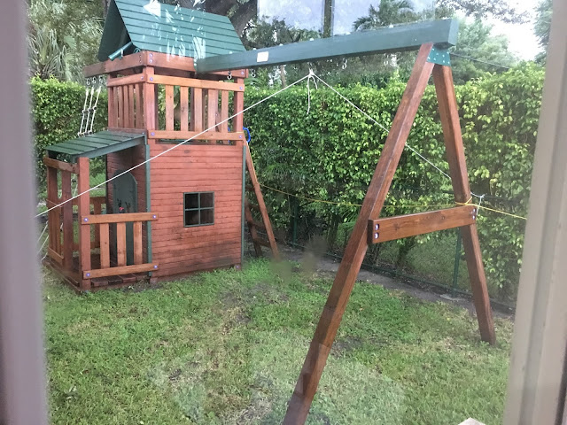 Swing set tied down with ropes