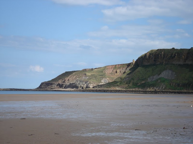 Cayton Bay on a sunny day when the beach is quiet