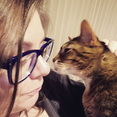 image of my face, close-up and in profile, as Sophie the Torbie Cat leans her face in toward mine
