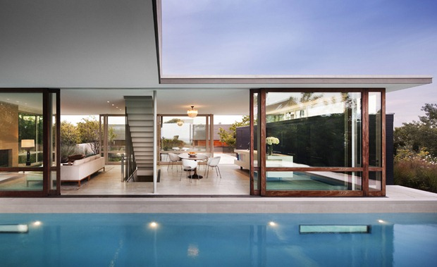 Photo of sirfside residence interiors as seen from the pool area outside