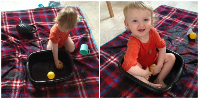 toddler playing with bowwl of water and then sat in it