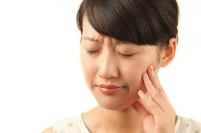 Nhổ răng cấm bao lâu thì lành