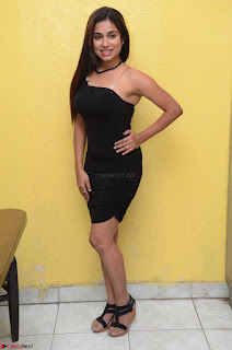 Vrushali Gosavi in strapless Short Black Dress At Follow Follow U Audio Launch 075.JPG