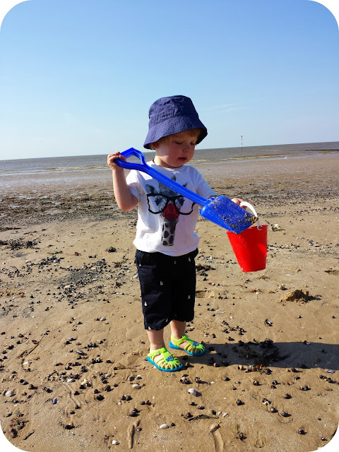 toddler on the beach, building sandcastles, debenhams kidswear