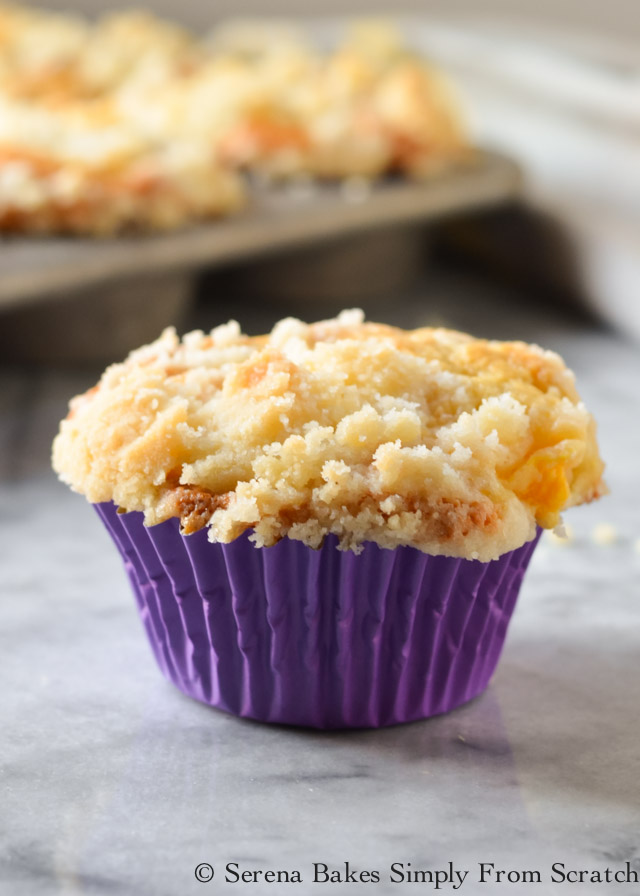 Peach Crumb Muffins are a cake like peach muffin with coffee cake style crumb from Serena Bakes Simply From Scratch.