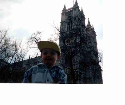 Small child in big hat in front of Westminster