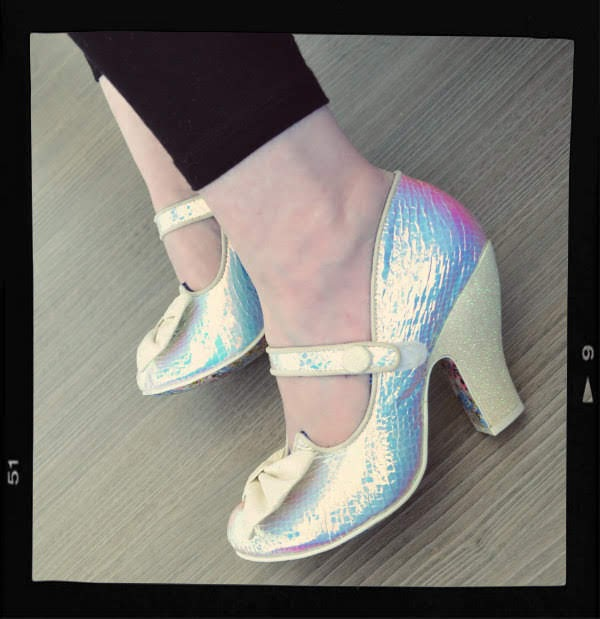 side view of strap fastening on holographic shoes