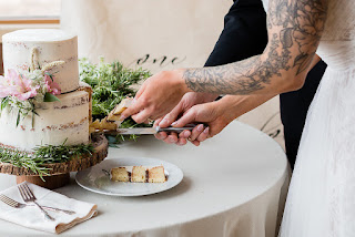 cutting floral wedding cake