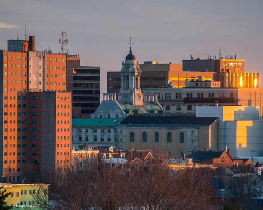Portland, Maine USA March 2017 photo by Corey Templeton. Late afternoon sun hitting City Hall and the surrounding buildings, from the far side of North Street.