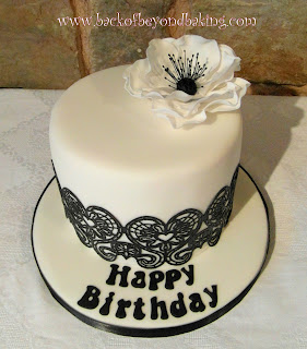 white poppy and black lace cake