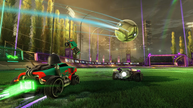 A car shoots the football towards the goal, between two opponents, from Rocket League