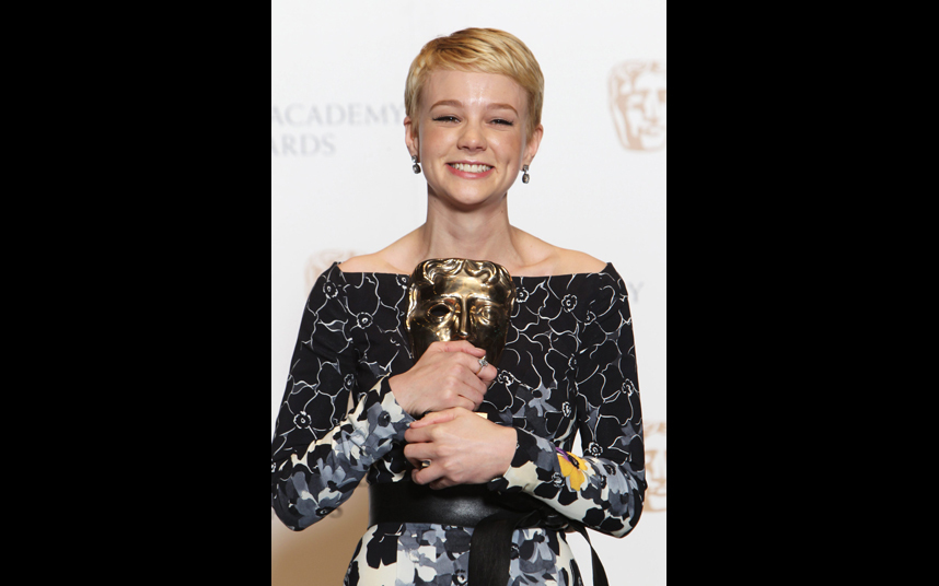 Mulligan with her BAFTA for Best Actress in a Leading Role, which she was awarded for her role as Jenny in An Education.