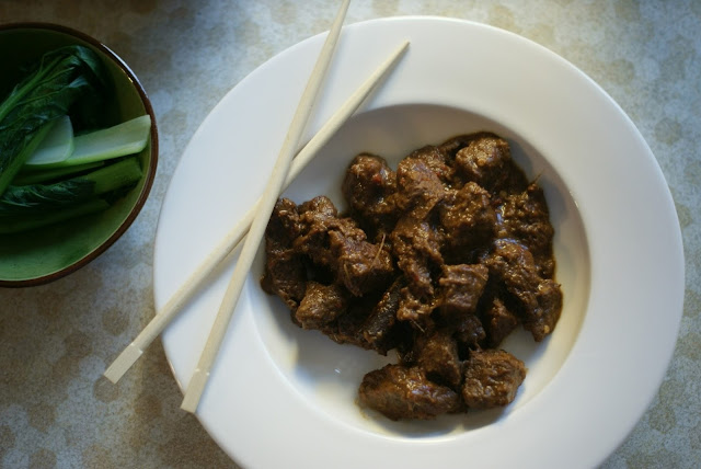 thai beef rendang with asain greens
