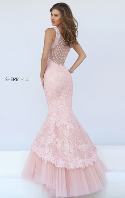 6a2d315c693 Leave the crowd breathless in Sherri Hill 50112. Halter neckline with  beaded trim with linear cutout in front feature this evening gown.