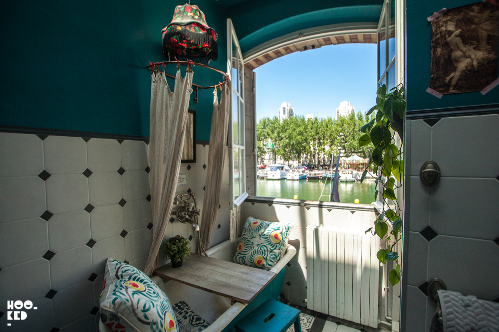 Inside Pavillon des Canaux looking out onto the canal in Paris, France