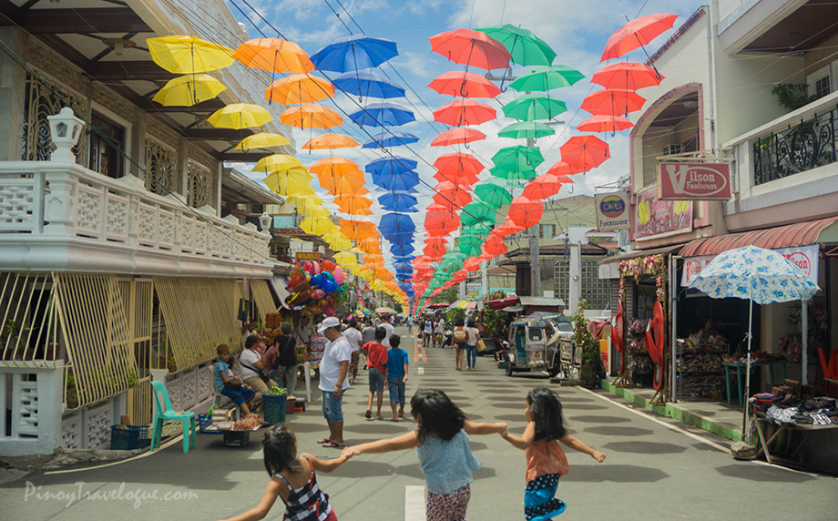 Colored umbrellas adorn a long stretch of Gat Tayaw Street