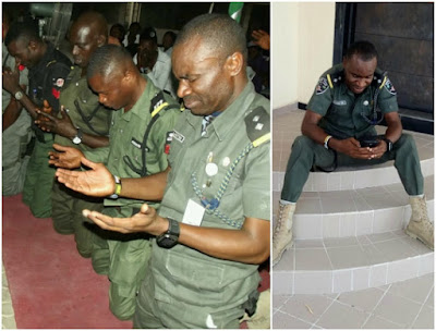 Police officers kneel to thank God for their safe return from the North after 3 months