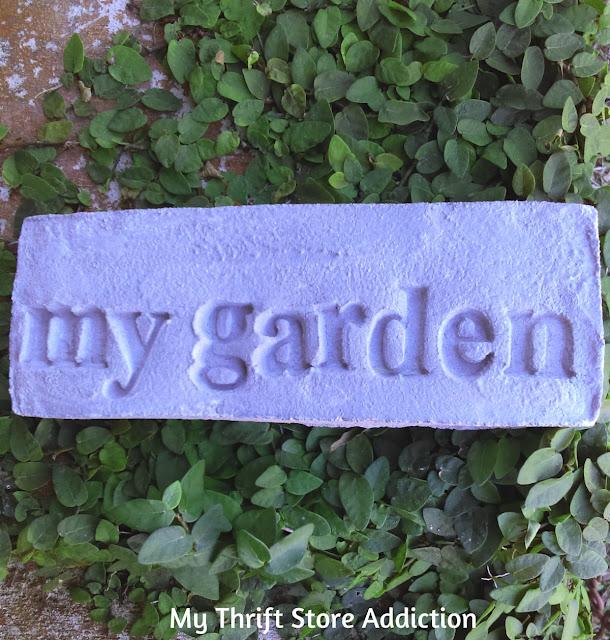 Secret Garden Herbs stamped cement stones