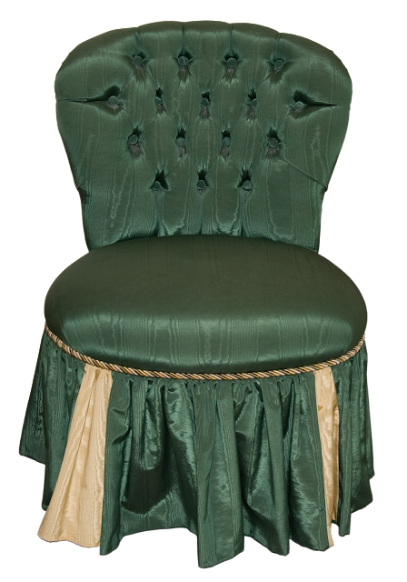 A button-tufted Victorian Chair in dark green peau de soie with tri-colored cording and a skirt.