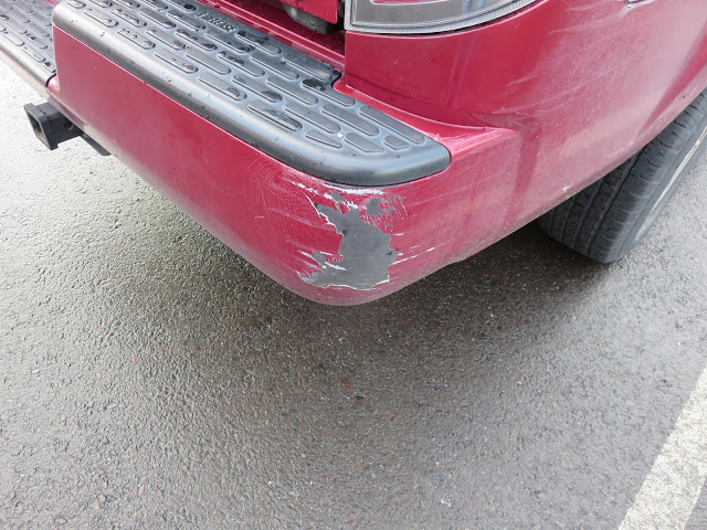 Scraped bumper on Honda Ridgeline Pick up before repairs at Almost Everything Auto Body