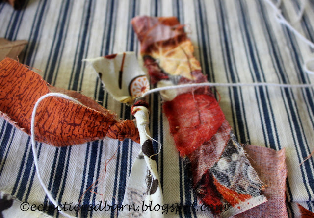 Eclectic Red Barn: Tying fabric strips to thread on fall Garland