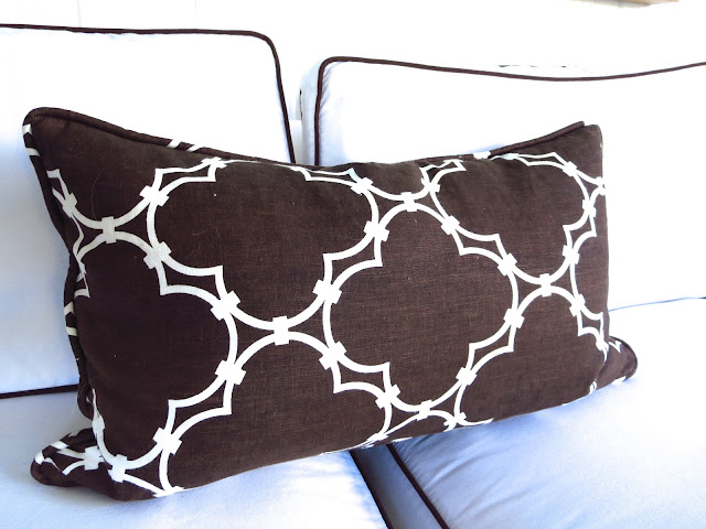 COCOCOZY Quatrefoil pillow on a white sofa with brown trim in Coco of COCOCOZY's living room