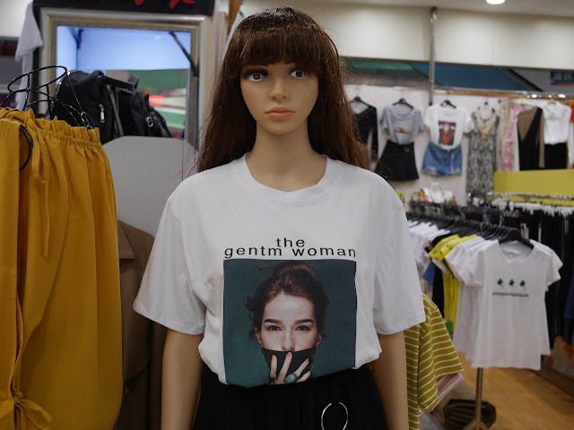 "female mannequin wearing ""the gentm woman"" shirt"