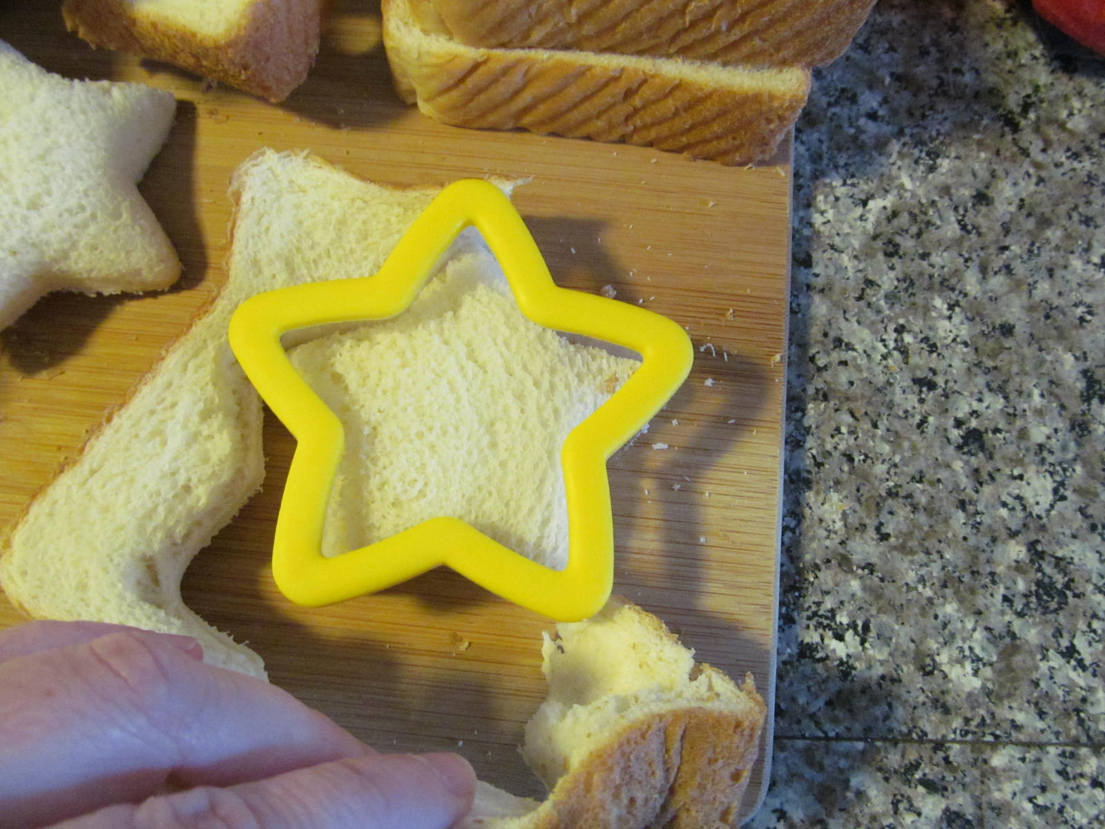 Place The Bread On A Cutting Board And Center The Star Shape In The Middle  Of The Slice Press Down Firmly And Tear Away The Excess Bread From The  Around