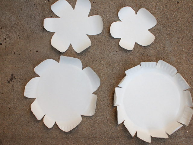 curl the petals of the paper plate flowers with pencils, pens, or markers