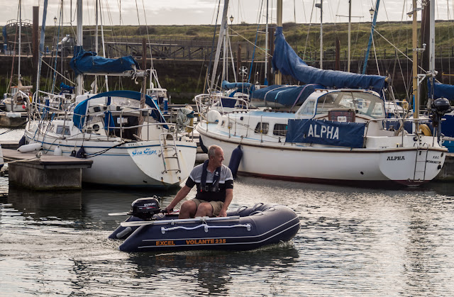 Photo of Phil test driving our new dinghy