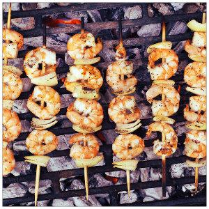 shrimp kabobs on a bbq