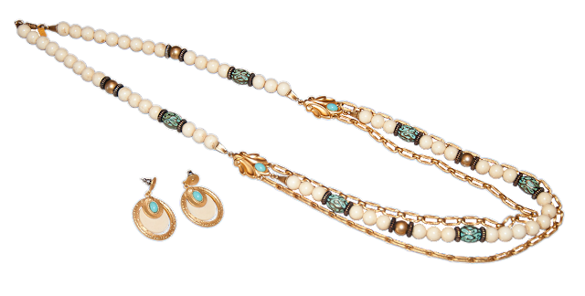 A modern necklace of white and gold beads, with long turquoise beads and gold chains. Includes a pair of matching earings.