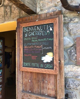 The menu at Rifugio Gherardi including, on this day, pasta, brasato, arrosto and zuppa farro e orzo.