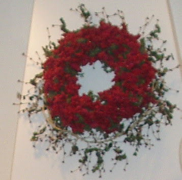 Old red berry wreath over a ivy wreath