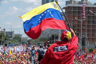 """the military has barricaded a border bridge linking the countries, with Maduro describing the aid as a """"political show"""" and a pretext to a US intervention."""