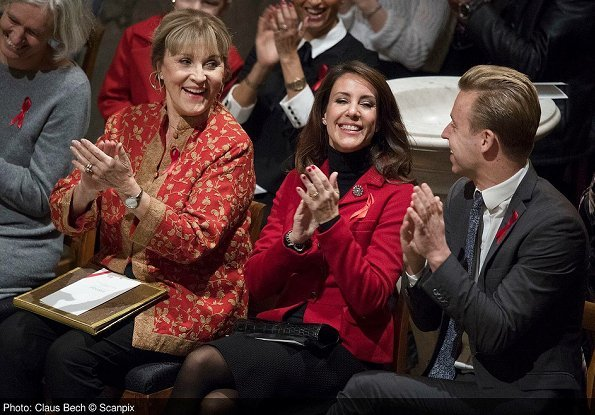 Princess Marie attended the Annual Christmas Concert held by Danish Aids Foundation at Trinitatis Church. gift